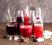 Bottle with fresh homemade berry lemonade with pulp Stock Photography