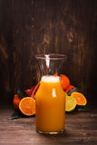 Bottle of fresh homemade citrus juice Royalty Free Stock Image