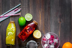 Bottle of fresh lemonade, fruits and ice cubes on wooden background top view copyspace Royalty Free Stock Photo