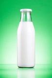 Bottle of fresh milk isolated on green Royalty Free Stock Photo