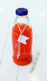 A bottle of fresh tasty organic tomato juice Royalty Free Stock Photography