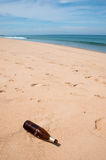 Bottle is garbage at beach Stock Image