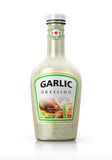 Bottle with garlic dressing Stock Photography