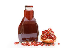 Bottle with garnet juice and pomegranate Royalty Free Stock Images