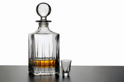 Bottle and glass. Whisky decanter and empty glass isolated on white Stock Photography