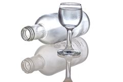 Bottle & glass. Overturned bottle after vodka and glass royalty free stock image