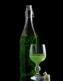 Bottle and glass of absinthe. With sugar on black background stock photo