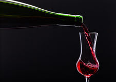 Bottle and glass with alcoholic drink Royalty Free Stock Image