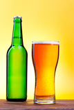 Bottle and glass with beer Royalty Free Stock Photos