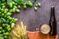 Bottle and Glass beer with Brewing ingredients. Hop flower with wheat. Top view. Copy space. Still life. Flat lay stock photo
