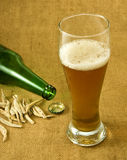 Bottle, a glass of beer and dry fish Royalty Free Stock Image
