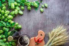 Bottle and glass beer with wheat and hops as brewing ingredients in top view and copy space area. Flat lay. Still life Royalty Free Stock Image