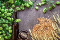Bottle and glass beer with wheat and hops as brewing ingredients in top view and copy space area. Flat lay. Still life Stock Photos