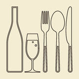 Bottle, glass of champagne, fork, knife and spoon Stock Photo
