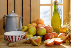 Bottle and glass of cider with apples Royalty Free Stock Photography