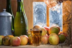 Bottle and glass of cider with apples Stock Photo