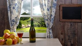 Bottle and glass of cider with apples. In rustic house. Bottle and glass of cider with apples. In the rustic house stock video footage