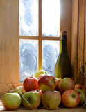 Bottle and glass of cider with apples Royalty Free Stock Photo