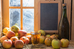 Bottle and glass of cider with apples Stock Image