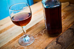 Bottle and glass of cognac with ice Stock Photography