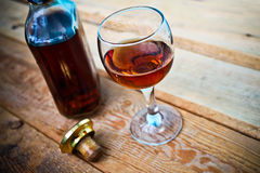 Bottle and glass of cognac with ice Stock Photo