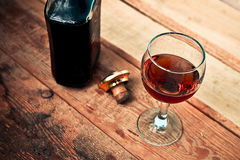 Bottle and glass of cognac with ice Stock Images