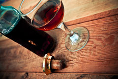 Bottle and glass of cognac with ice Royalty Free Stock Image