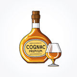 Bottle and a glass of cognac Royalty Free Stock Photography