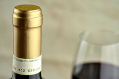Bottle and glass of fine italian red wine. Closeup Royalty Free Stock Photography