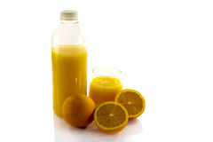Bottle and glass with fresh orange juice Stock Images