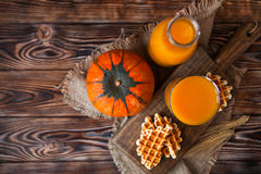 Bottle and Glass of healhty fresh pumpkin juice with wafer and p Royalty Free Stock Photos
