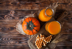 Bottle and Glass of healhty fresh pumpkin juice with wafer and p Stock Photography