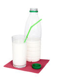 Bottle and glass of milk with green drinking straw on red napkin Royalty Free Stock Image