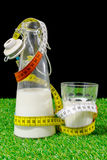 Bottle and glass of milk with a tape measure Stock Photo