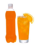 Bottle and glass with orange drink Royalty Free Stock Image