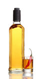 Bottle and glass of pepper vodka Stock Image