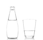 A bottle and a glass of pure fresh water isolated. On white background Royalty Free Stock Photos