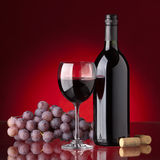 Bottle and glass of red wine Stock Image