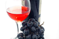 Bottle and glass of red wine. Glass of red wine and bunch of grapes on a white background stock photos