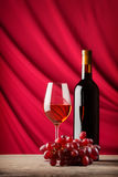 Bottle and glass of red wine on a background of Royalty Free Stock Images