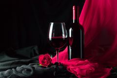 Bottle and glass with red Stock Images