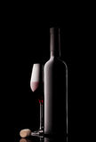Bottle and glass of red wine with cork Stock Images