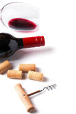Bottle, glass with red wine, corks and corkscrew Stock Photography