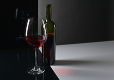 Bottle and glass with red wine Royalty Free Stock Photography