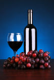 Bottle and glass of red wine with grapes Royalty Free Stock Images