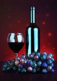 Bottle and glass of red wine with grapes Royalty Free Stock Photos