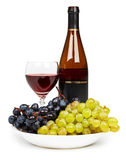 Bottle, glass with red wine and grapes Stock Image