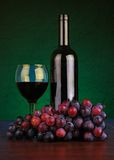 Bottle and glass of red wine with grapes Royalty Free Stock Image