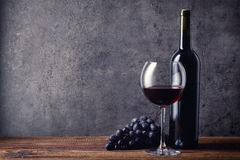 Bottle and glass of red wine and grapes Royalty Free Stock Photography