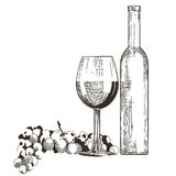 Bottle and Glass of Red wine with grapes  Stock Photography
